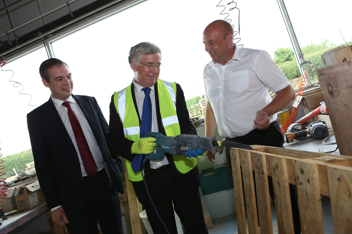 SITE VISIT: Business Minister Michael Fallon, centre, with James Wharton, Stockton South MP, left, and Owen Hines, Returnable Packaging Services' general manager
