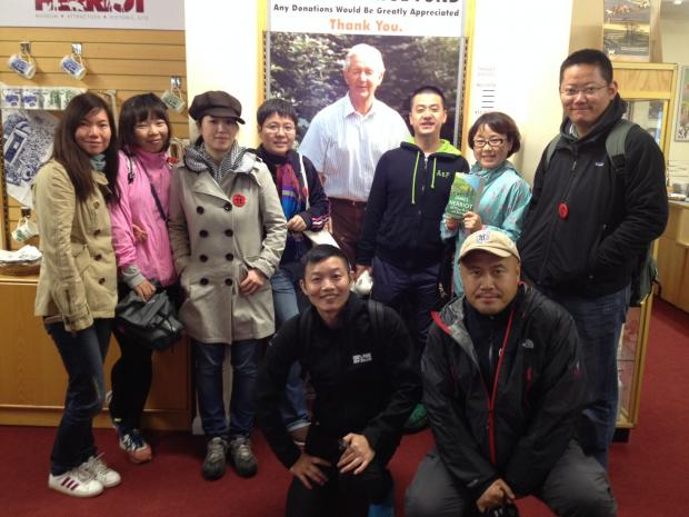 HERRIOT FANS: The Chinese journalists gather by a image of the author.