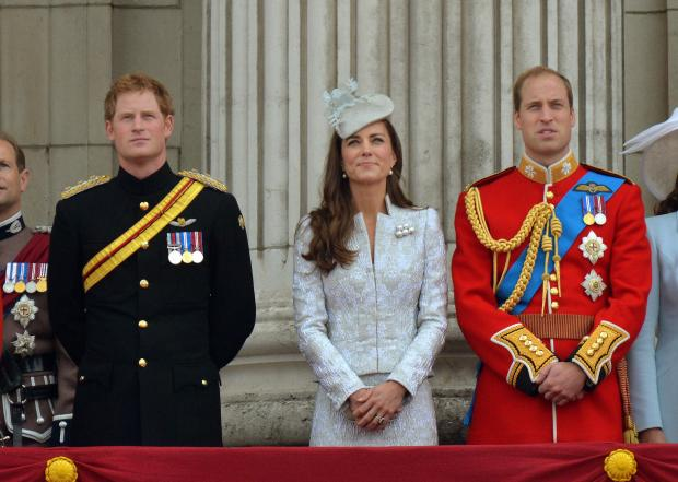 The Northern Echo: YORKSHIRE BOUND: Prince Harry, the Duchess of Cambridge and the Duke of Cambridge watch a fly-past by the RAF on the balcony at Buckingham Palace following the Trooping the Colour parade, London. Photo: John Stillwell/PA Wire.