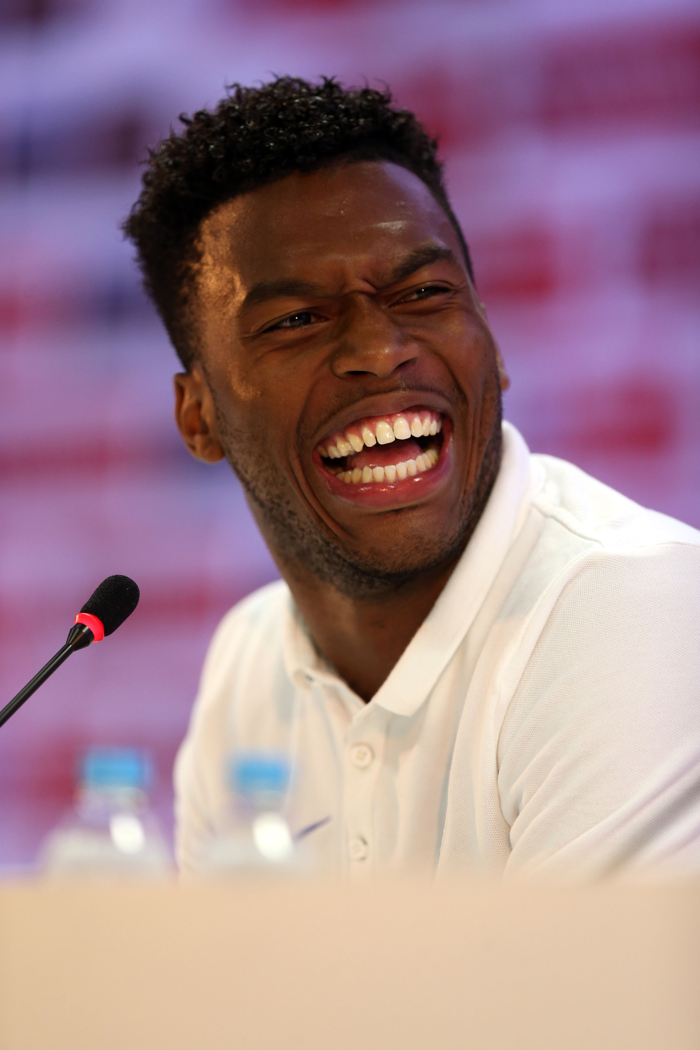 HAVING A LAUGH: Daniel Sturridge shares a joke during England's press conference in Rio yesterday