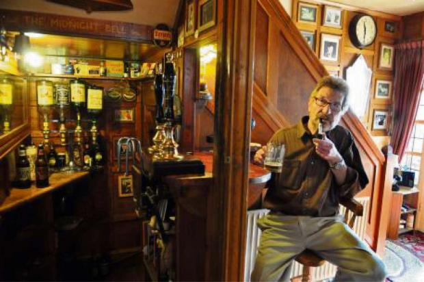 PINT-SIZE: Mick Waite in his pub-under-the-stairs.