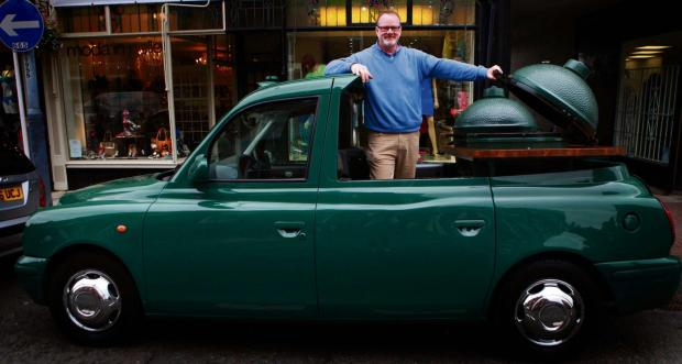 The Northern Echo: WHEELY TASTY: Andrew Brown with his mobile barbecue, which has been converted from a London cab. Picture:SARAH CALDECOTT