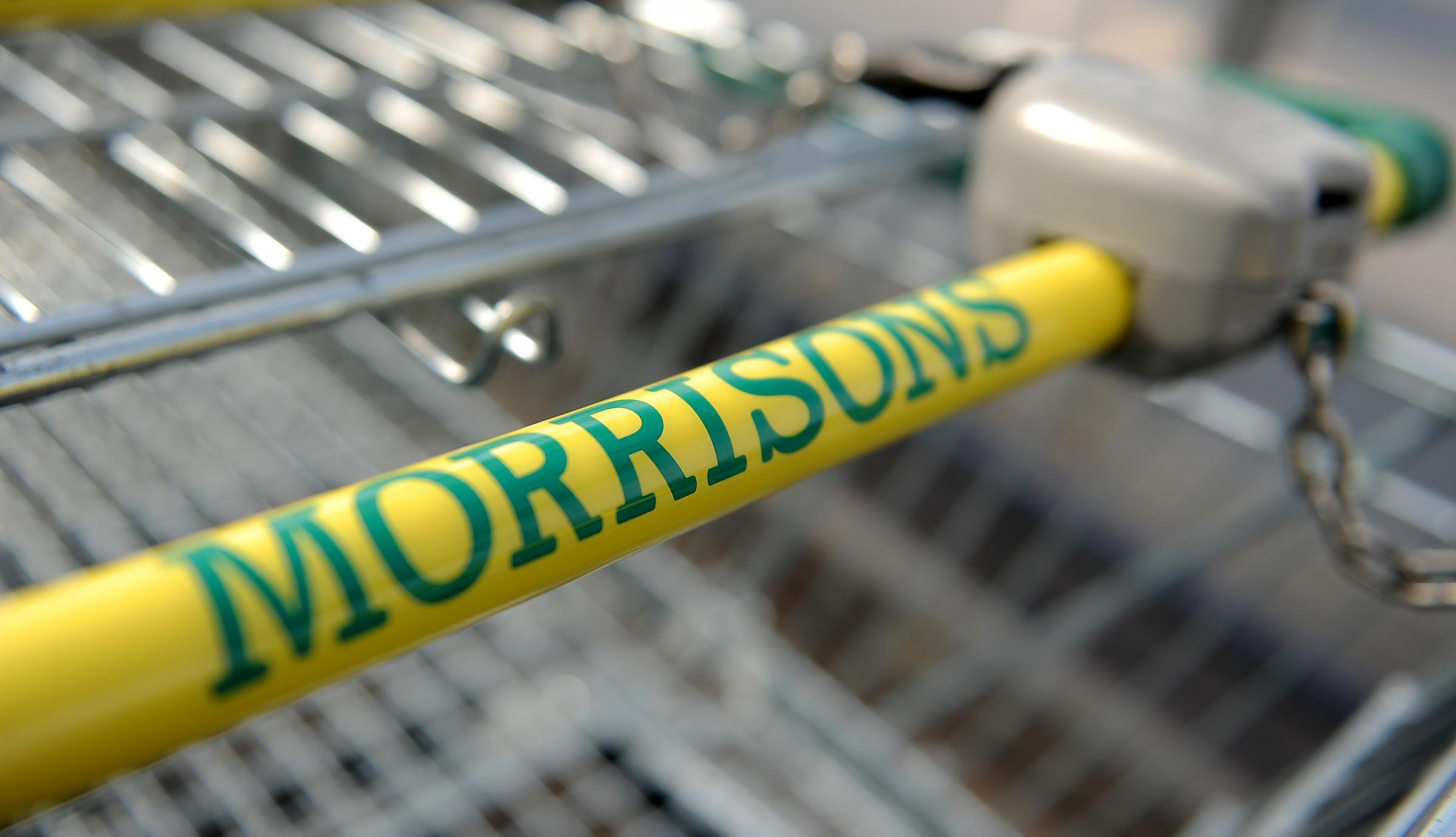 General view of signage for Morrisons supermarket on a trolley handle (7244394)