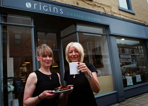 COFFEE LOUNGE: Jennifer Wicks and Carol Armstrong, staff members at the newly opened Origins coffee lounge, in Grange Road. Picture:SARAH CALDECOTT