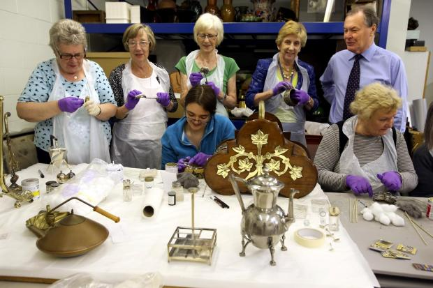 The Northern Echo: SUMMER CLEAN: Members of the Linthorpe W.I. at the Dorman Museum on Linthorpe Road, Middlebrough give the antique Dresser pottery a clean.  Pictured are Pauline Coates, Mary Ellis, Margaret Stephenson, museum volunteer Lauren Eccles (sitting), cllr Brenda