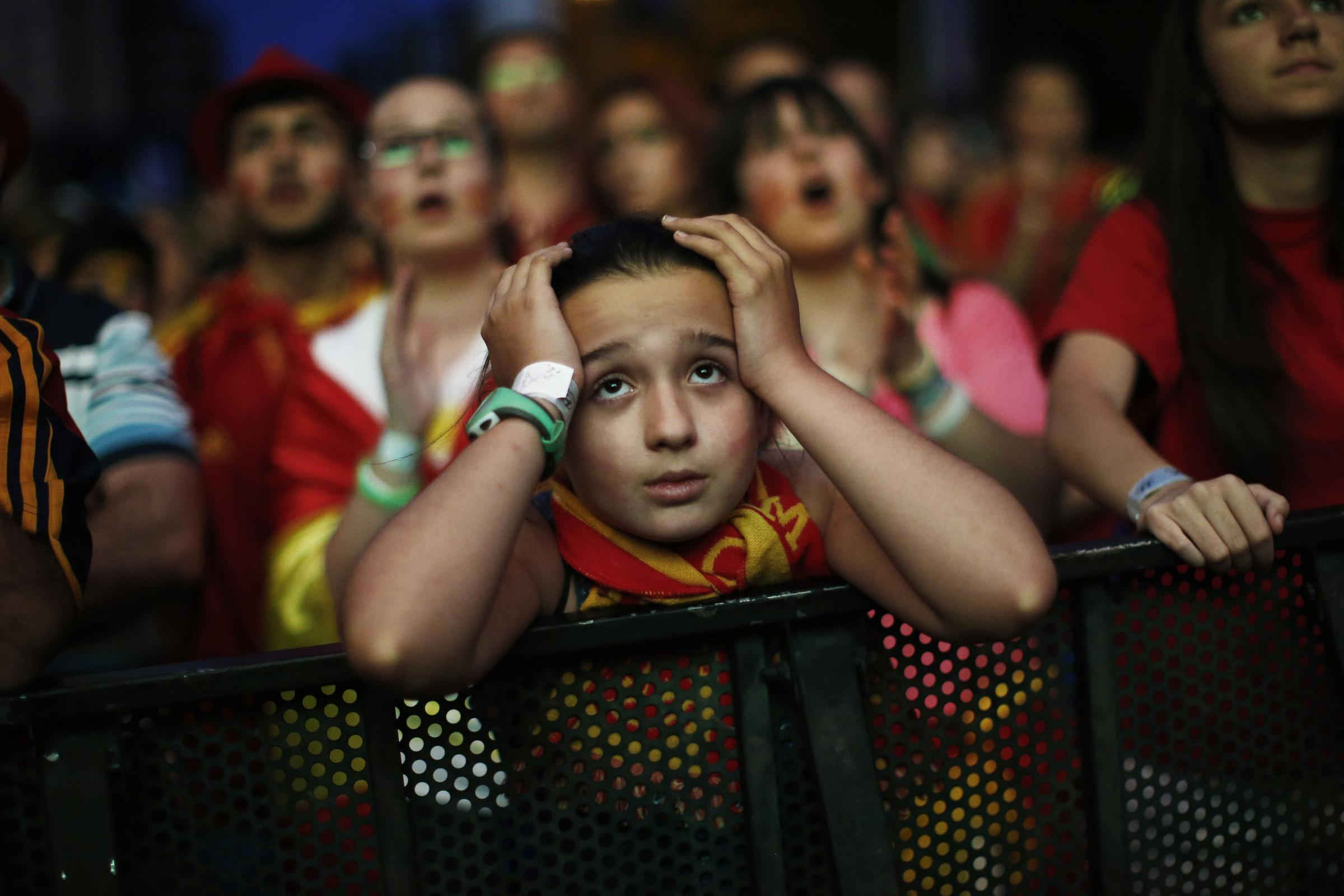 PAIN FOR SPAIN: A Spain supporter holds her head in her hands after Wednesday's defeat to Chile dumped the reigning champions out of the World Cup after just two games