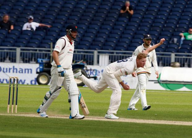 RUNNING IN: Durham's Ben Stokes bowling in the victory over Lancashire, the first LV= County Championship win of the season for the champions