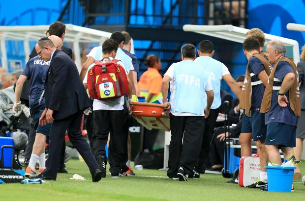 BAD LUCK: England physio Gary Lewin is stretchered off after dislocating his ankle celebrating Daniel Sturridge's goal against Italy Picture: Mike Egerton/PA Wire