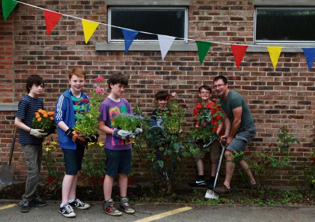 BIG CLEAN: A community comes together for big spring clean, decoration at St Augustine's Parish Centre. Picture: SARAH CALDECOTT