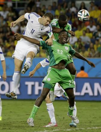 CHALLENGING HARD: Kenneth Omeruo (number 22) challenges Edin Dzeko for a header during Nigeria's 1-0 win over Bosnia on Saturday night
