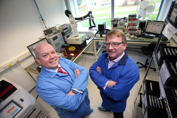 BUSINESS BOOST:  Alan Needle, Filtronic chief executive, right, with Dr Simon Goon, Business Durham managing director, pictured previously at the company's new Sedgefield base