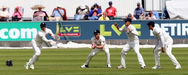 JUGGLING: Durham wicketkeeper Phil Mustard pouches a catch as the slip cordon looks on. Picture: DAVID WOOD