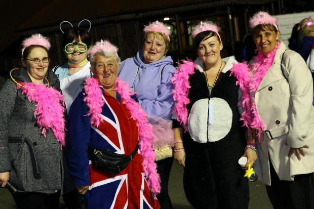 LATE NIGHT: Some of the walkers prepare for action in support of St Teresa's Hospice