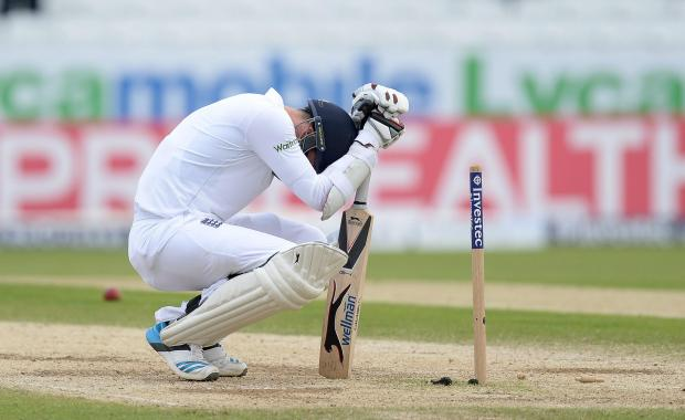 DRAMATIC DEFEAT: Jimmy Anderson tries to come to terms with losing his wicket - and the Test - on the penultimate ball