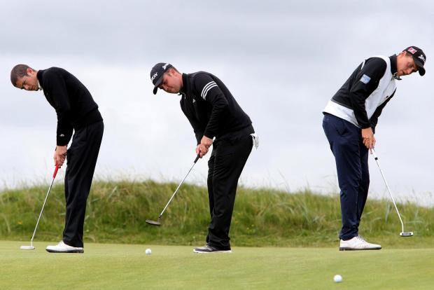 PRACTICE MAKES PERFECT: James Simpson (left), Daniel Garner and James Allan on the putting green at Seaton Carew. Picture: DAVID WOOD