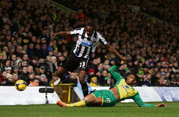 LENDER FINE: Wonga has been ordered to pay £2.6m compensation. The firm sponsors Newcastle United's shirts, shown here last season as Shola Ameobi battles with Norwich City's Leroy Fer