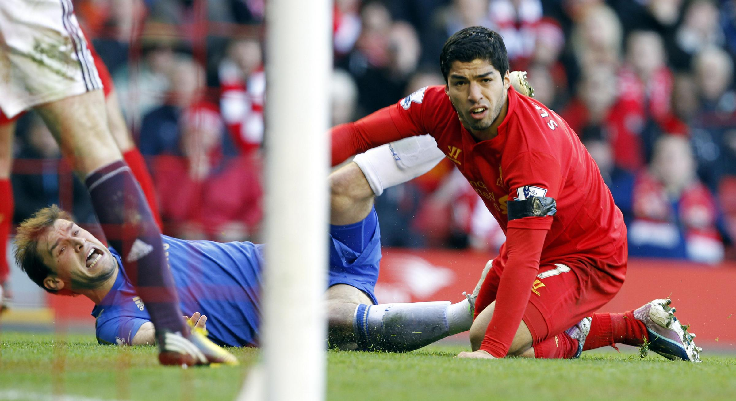 Luis Suarez, right, and Chelsea's Branislav Ivanovic on the ground after Suarez bit Ivanovic during the Barclays Premier League match at Anfield, Liverpool, in April last year