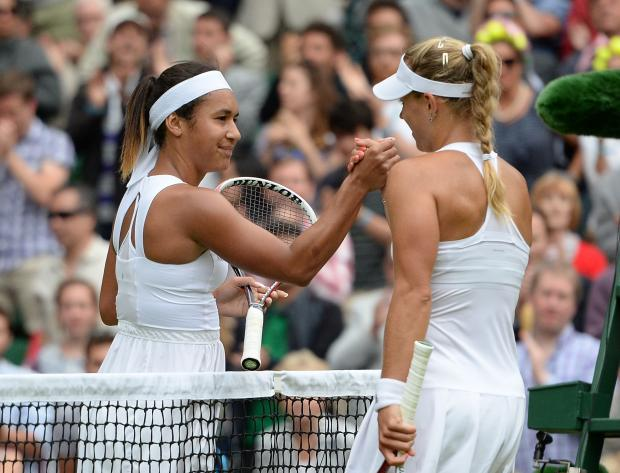 Great Britain's Heather Watson, left, shakes hands with winner Germany's Angelique Kerber