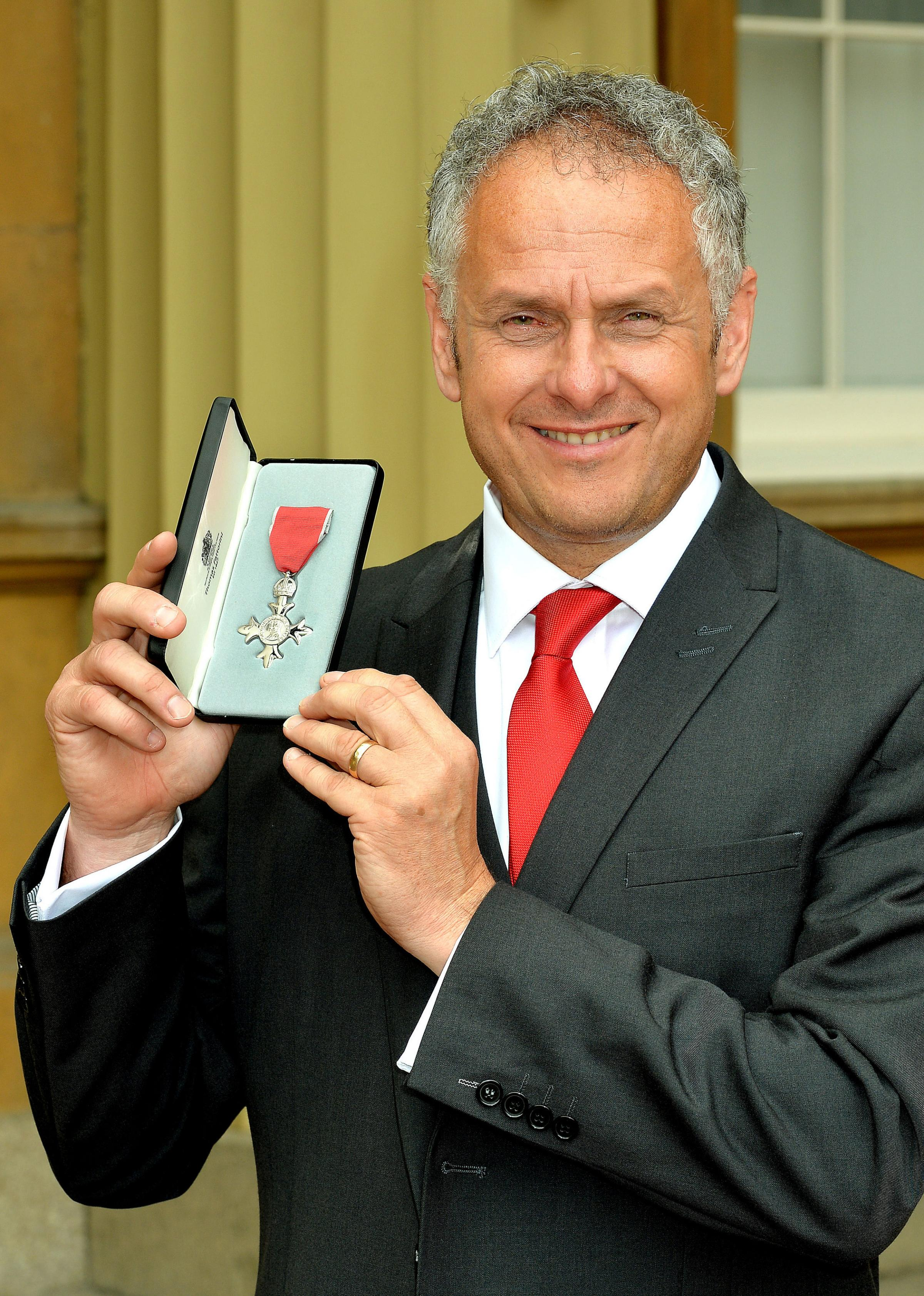 Peter Barron after receiving his MBE from Prince Charles
