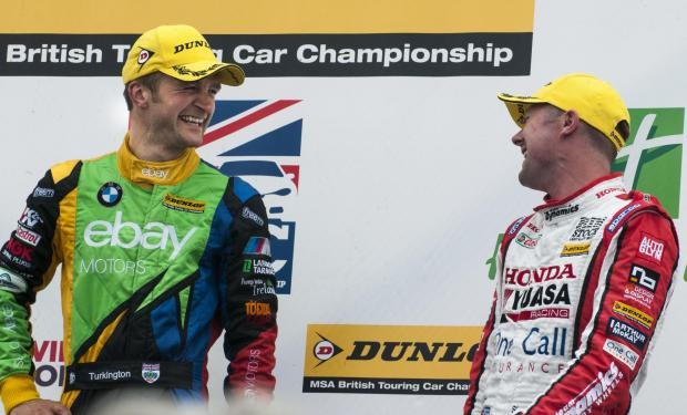 DOUBLE: Colin Turkington shares a joke with Gordon Sheddon on the podium after winning race two - his second of the day. Pictures: Michael Atkinson
