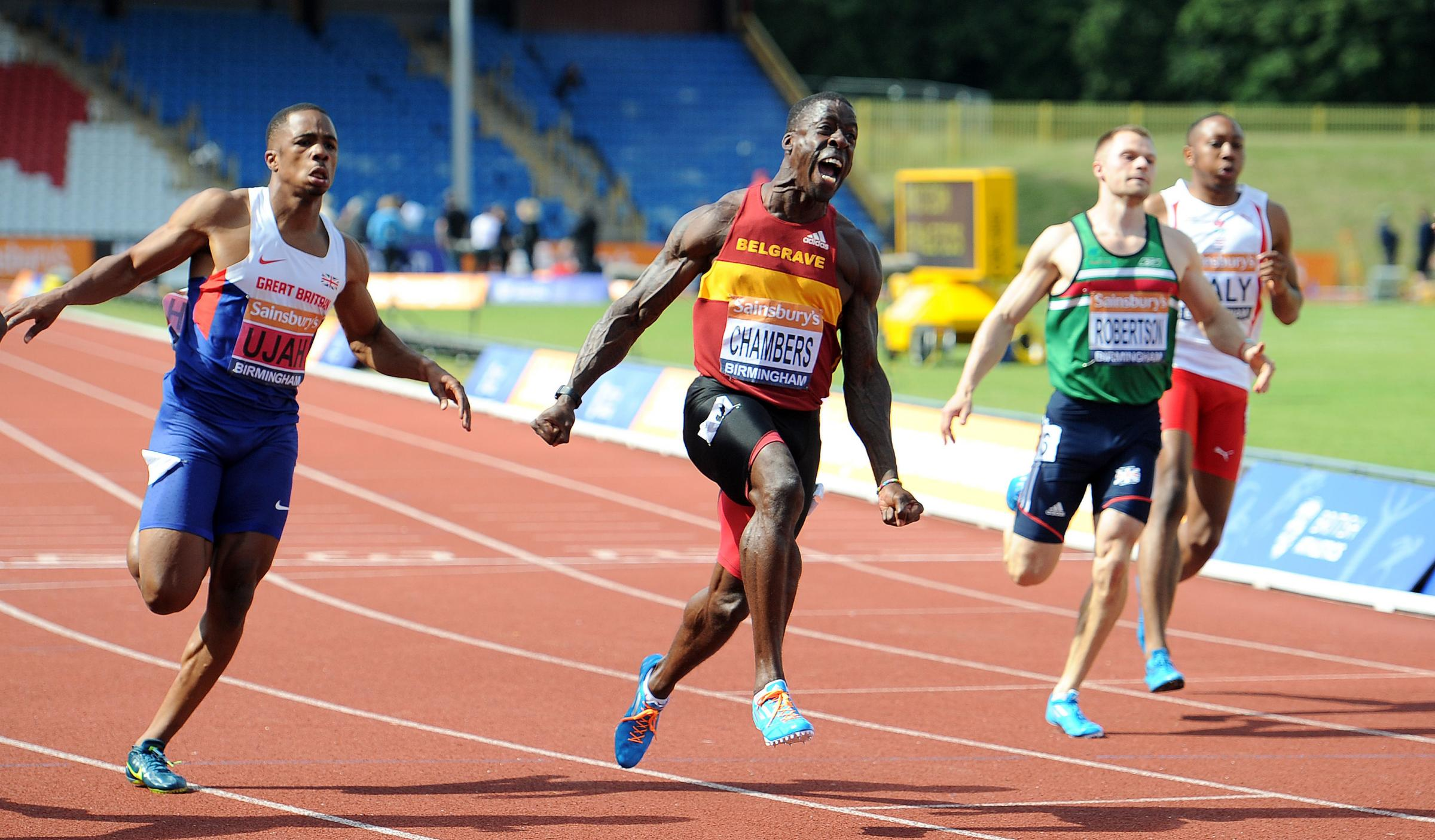 CHAMBERS VICTORY: Dwain Chambers celebrates his 100m victory while Middlesbrough's Richard Kilty, not pictured, finished fourth in the event in Birmingham yesterday