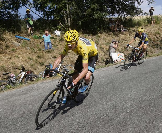 HIGH SPEED: Chris Froome, wearing the yellow jersey, and Spain's Alberto Contador, race along a stage at last year's Tour de France. This year's event starts in Yorkshire and Fridge Productions has made a video highlighting the spectacle.