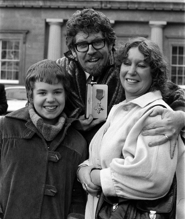 Rolf Harris with his wife Alwen and his then 13-year-old daughter, Bindi, at Buckingham Palace after he was awarded the OBE at an investiture