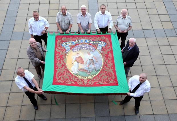 BANNER LIFTED: Volunteers given permission to carry Hole In The Wall banner at the Durham Miner's Gala for the first time in decades.  Pictured outside the Civic centre in Crook are (clockwise from bottom left) David Parker, Ray Williams, Roger Ward,