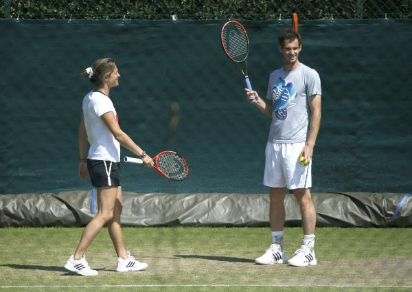 RELAXED OUTLOOK: Coach Amelie Mauresmo with Andy Murray on the Wimbledon practice courts yesterday