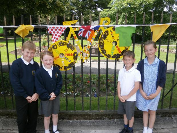 The Northern Echo: STILL SMILING: Richmond Church of England Primary School pupilsFrankie Stephen, Erin Stephen, Sam Brooks and Olivia Brooks with one of their works of art which was not damaged by vandals.