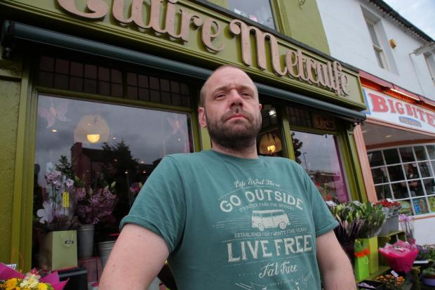 The Northern Echo: ANGRY TRADER: Rob Metcalfe at his florist shop in Bondgate, Darlington. Picture: ANDY LAMB