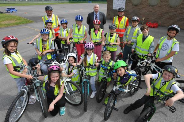 Year 6 pupils from St Teresa's School in Hartlepool are pictured during the Bikeability course with (from back left) instructor Ash Cowan, Paul Watson, and instructor Kenny Braham.