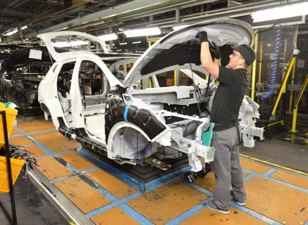 PRODUCTION LINE: A Nissan production line worker tends to a Qashqai at the firm's Sunderland plant