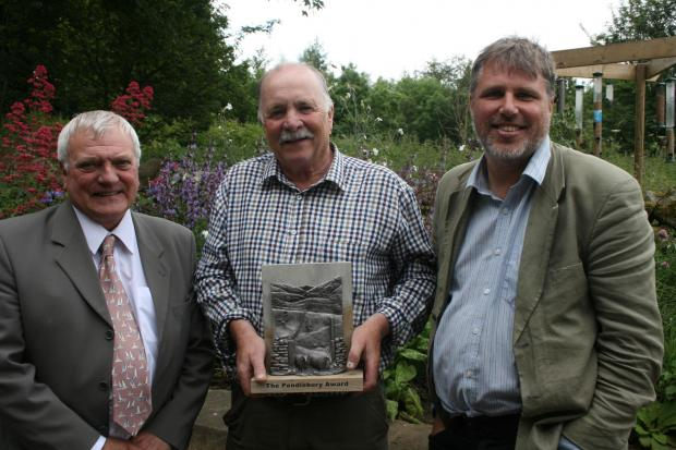 AWARD WINNER: Dave Liddle (centre) receives the Pendlebury Award from AONB chairman Eddie Tomlinson (left) and partnership director Chris Woodley-Stewart