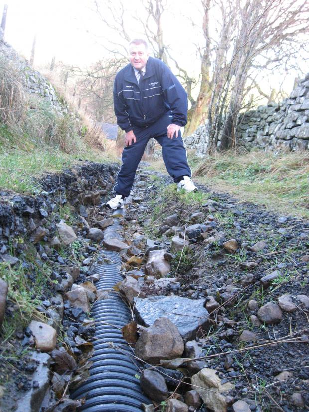 The Northern Echo: WASHED AWAY: Weardale County Councillor John Shuttleworth is calling for the Lonen to be fixed