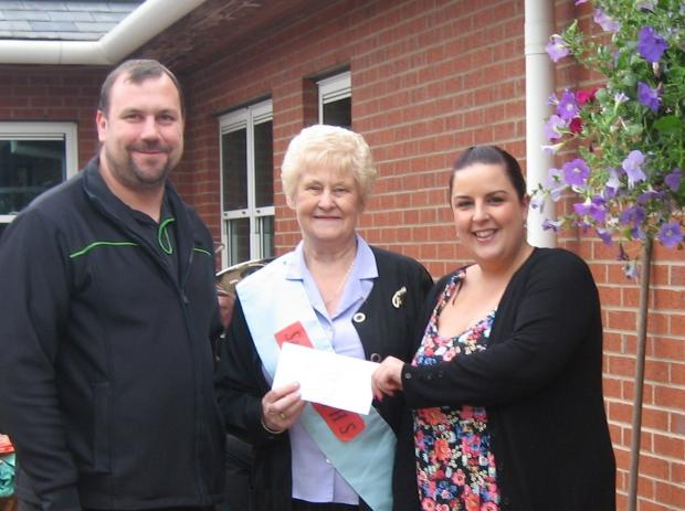 RAFFLE DONATION: Organiser Julie Welford  (centre) with Co-op managers Stephen Mould and Hayley Gibson