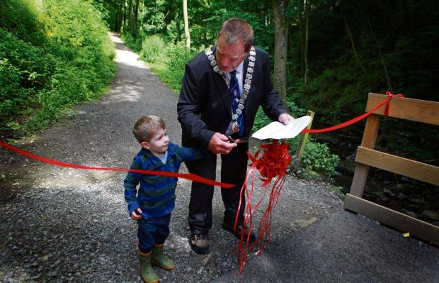 FLATTS WOOD: Barnard Castle Mayor John Blissett with grandson Isaac John Blissett, aged two, performs the ribbon cutting to mark the completion of improvements to Flatts Wood Picture: SARAH CALDECOTT