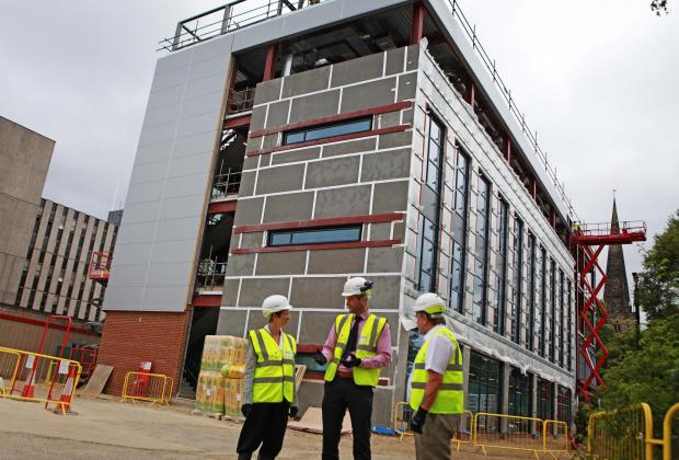 The Northern Echo: BUILDING SITE: The Department for Education building, in Darlington. Pictured are Darlington Borough Council chief executive, Ada Burns, with council leader, Bill Dixon, right, and Sean McNicholas, the project's senior building manager. Picture: SARAH