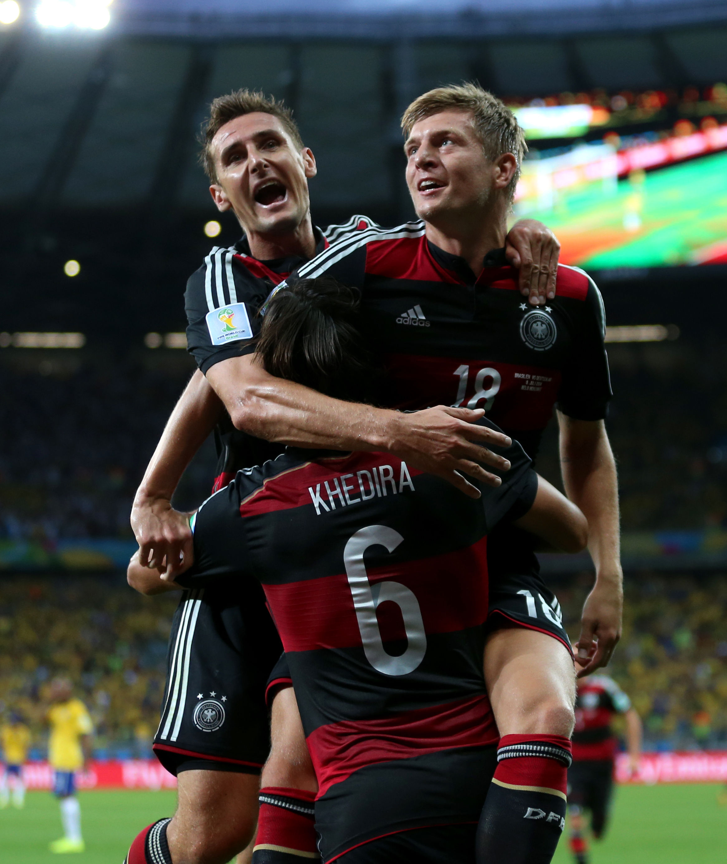 REMARKABLE DISPLAY: Toni Kroos celebrates scoring the fourth goal of Germany's 7-1 win over Brazil with team-mates Sami Khedira and Miroslav Klose