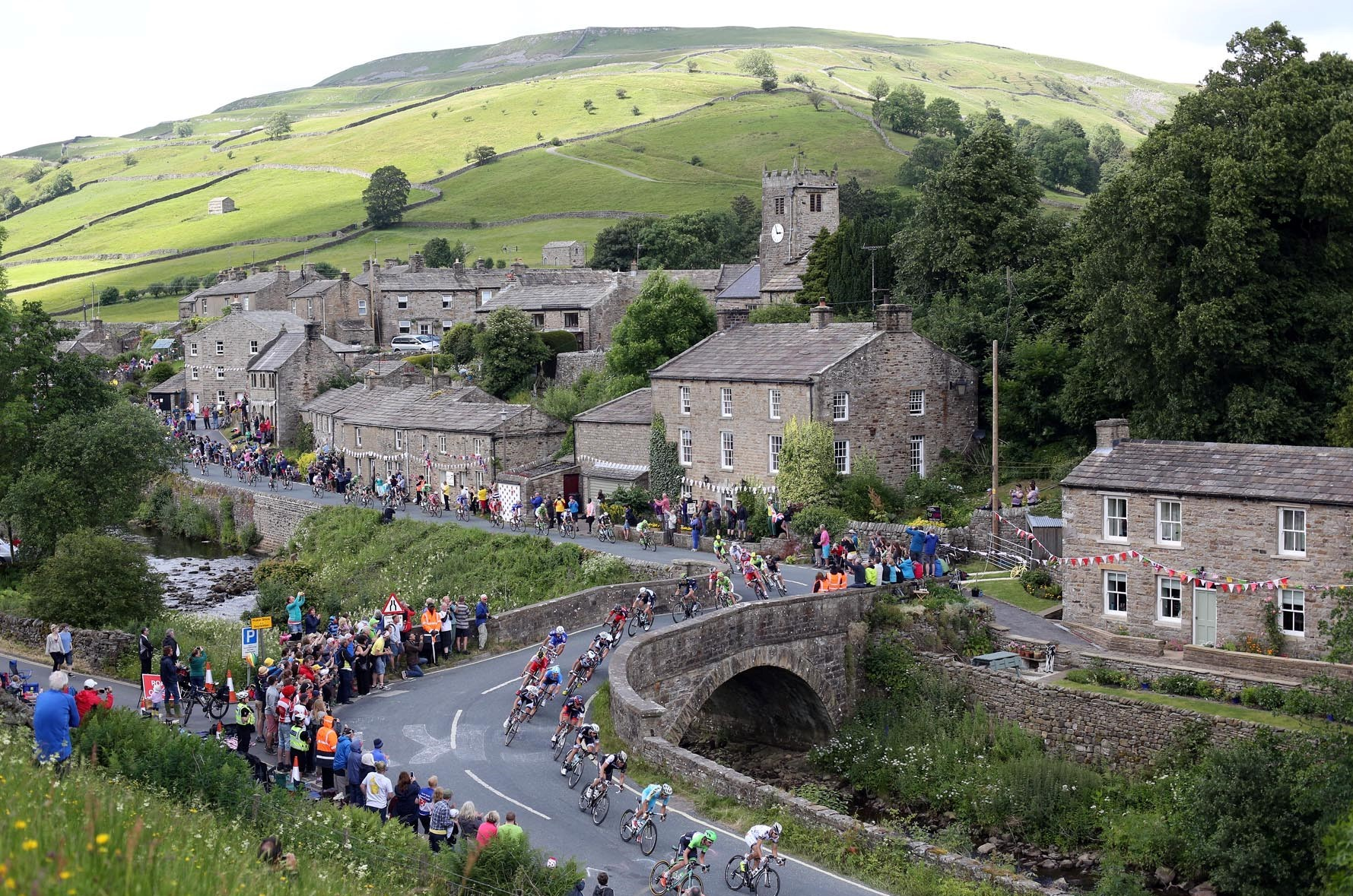 RACE DAY: The cyclists at Muker as stage one of the Tour de France passes through Swaledale, North Yorkshire.  Picture: CHRIS BOOTH