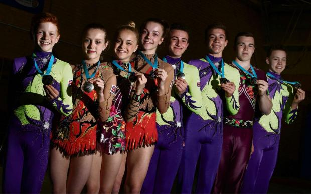 WORLD CHAMPIONS: Eight gymnasts from Deerness Gymnastics Academy returned from the World Acrobatic Championships with gold medals. Pictured are Finn Gavin, Abbi Greaves, Millie Nesbitt, Chelsea Fisher, Stuart Napier, Michael Gill, Liam Sneath and Nathan B