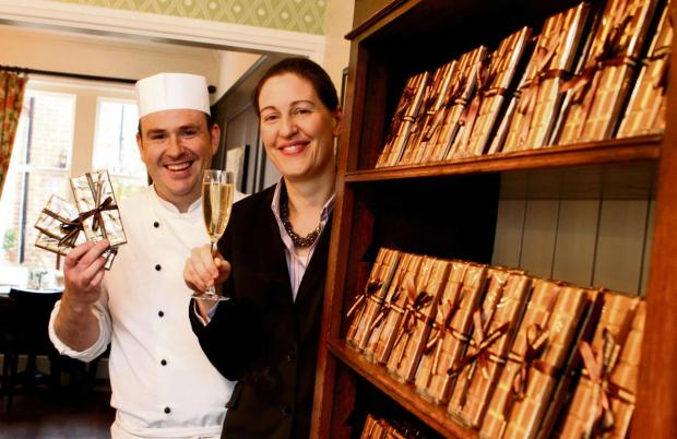 GOLDEN TIOKET: Frederic and Jane Robineau, previously pictured highlighting the first year of their business' cafe by putting golden tickets into chocolate bars