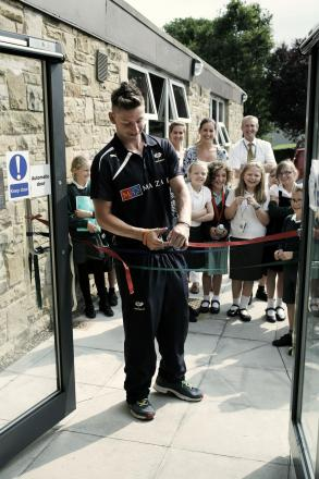 SCHOOL EXTENSION: Former pupil and Yorkshire cricketer Lewis Stabler cuts the ribbon during the opening ceremony of a new extension at Richmond Methodist Primary School. Picture: STUART BOULTON