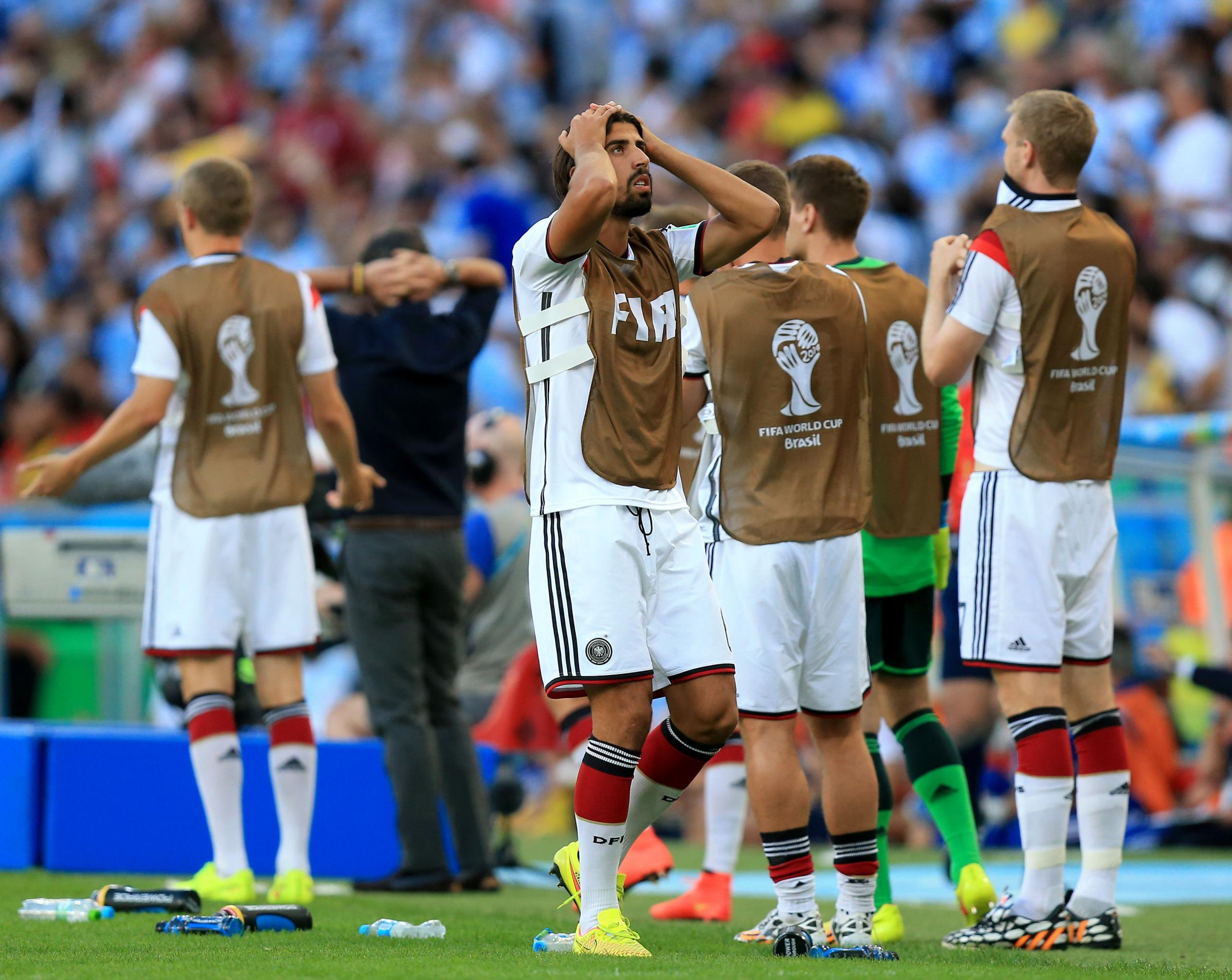 AGONY WATCHING: Germany midfielder Sami Khedira, centre, was ruled out of the World Cup final after sustaining an injury during his team's warm-up