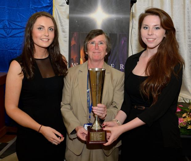 PRIZE-GIVING: Carmel College principal Maura Regan (centre) with joint winners of the Sylvia Pursey Vocalist Prize, Amelia Hughes (left) and Molly Cunningham