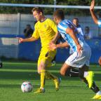 The Northern Echo: Guiseley's Gavin Rothery breaks away from Huddersfield Town's Matt Crooks and Duane Holmes