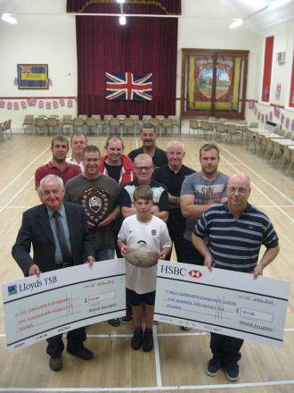RUGBY FUNDRAISER: Rugby players from West Cornforth and Durham City present cheques to Alan Hodgson, of Cornforth Partnership, and Paul Ferguson, of West Cornforth Community Association
