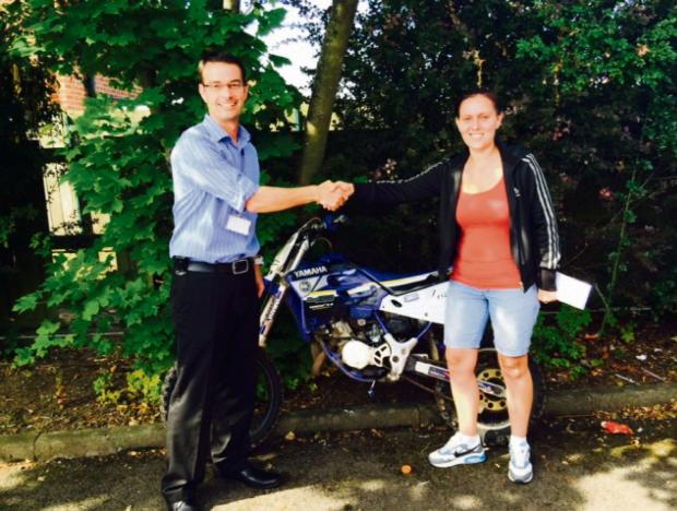 WELL DONE: Kirsty McStravick, right, and Det Con Ian Banham, with her recovered bike