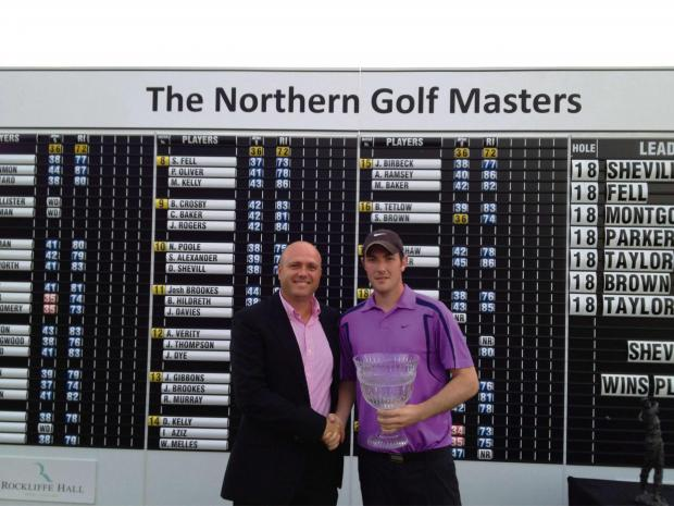 Champion: Daniel Shevill was presented with the Northern Masters trophy by Tour golfer Graeme Storm last year