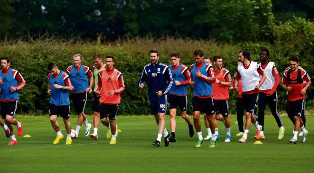 ON THE RUN: Middlesbrough players running on their first day back of pre-season